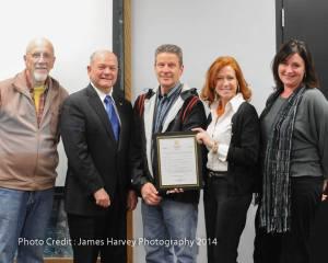 Micheal Butirro (center) helped announce Small Business Saturday in 2014